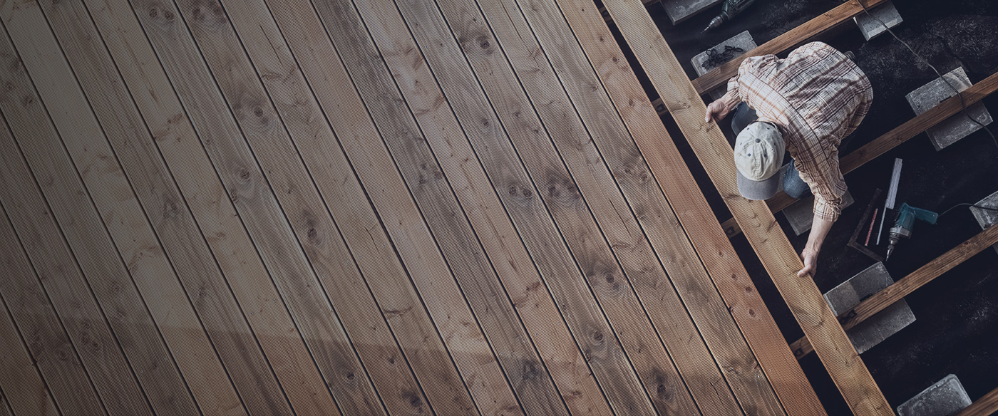 Man fixing wood flooring