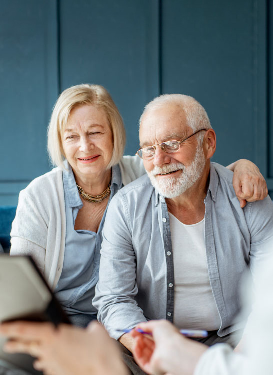 Older Couple signing contract